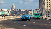 Classic car on the Malecon - waterfront with a view of the Capitol. Old Havana, Cuba