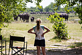 12 year old girl looking at elephants, Moremi Reserve, Botswana