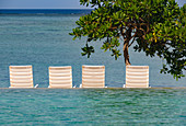 Sun loungers by the pool of the Hotel Shangri-La with a view of the Pacific, Yanuca Island, Fiji