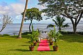 Preparing for a wedding on the tropical beach at Savusavu, Fiji Islands