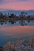 Full moon over Segnitz am Main at sunrise, Kitzingen, Lower Franconia, Franconia, Bavaria, Germany