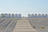 France, Somme, Bay of Somme, Cayeux sur Mer, popular seaside resort with its pebble beach and its 400 beach cabins, young boy running between the cabins