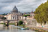 The view on Tiber River with bridge Sant'Angelo and Basilica di San Pietro in the background Rome Lazio Italy Europe