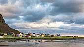 Clouds and midnight sun at the typical fishing village, Eggum, Unstad, Vestvagøy, Lofoten Islands, Norway, Europe