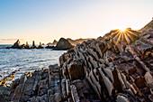 Playa Gueirua, Santa Marina, Asturias, Spain. La Forcada (The Pitchfork) sea stacks at sunrise