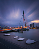 View of the Erasmus Bridge during blue hour, with long exposure before storm is coming, Erasmusbrug, Rotterdam, Willemsplein, South Holland, The Netherlands, Europe