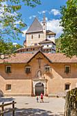 Mom and son visits San Romedio monastery, Sanzeno, Predaia, Non valley, Trento province, Trentino Alto Adige, Italy, Europe (MR)