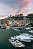 amazing coloured spring sunset at historic centre of Portovenere, La Spezia province, Liguria, Italy, Europe
