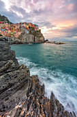a coloured sunrise on cliffs of Manarola, National Park of Cinque Terre, Manarola, municipality of Riomaggiore, La Spezia Province, Liguria district, Italy, Europe