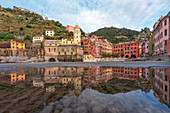 the old village of Vernazza, reflected in the pool, Cinque Terre, World Heritage Site, La Spezia province, Liguria district, Italy, Europe.