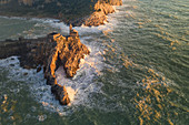 aerial view of a fiery sunset over the medieval San Pietro Church during a big sea storm, UNESCO World Heritage Site, municipality of Portovenere, La Spezia province, Liguria district, Italy, Europe
