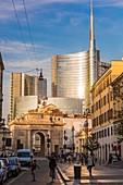 Italy, Lombardy, Milan, Corso Garibaldi, the door Garibaldi of the architect Giacomo Moraglia and view of the district Porta Nuova which the tower Unicredit bigger skyscraper of Italy