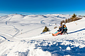 Tobogganing in the Seiser Alm ski area, South Tyrol, Italy