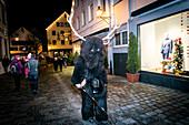 A Krampus runs through the old town, Klausentieben, Immenstadt im Allgäu, Oberallgäu, Bavaria, Germany, Europe