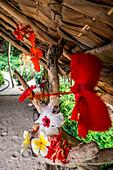Colorful tropical flowers in a hut, Efate, Vanuatu, South Pacific, Oceania