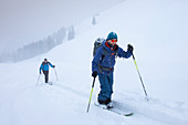 Two men on a ski tour in the Alpbach valley to the Gemskopf
