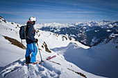 Skiers on the deep snow slope in the Zillertal Alps