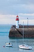 Morning mood at the Eruqy lighthouse - harbor entrance with boats. Brittany France