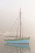 Old sailing ship in the port of Equy in the dense morning fog. Brittany, Cote d Armor, France