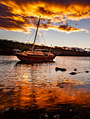 Sunset low tide with yatch in Donelly, Tasmania