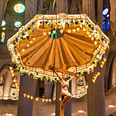 Altar with Jesus statue in the interior of the Sagrada Famlia by Antoni Gaudi, Barcelona, Spain