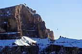 Cable car at Sass Pordoi, scenery, rocks, Dolomites, Trentino in winter, Italy