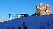 Hut in the ski area above Cortina d'Ampezzo, on the Cinque Torri, snow, Dolomites, ski lift, rocks, winter in Veneto, Italy