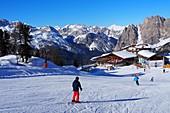 in the ski area under the Cristallo above Cortina d'Ampezzo, ski slope, snow, skiers, landscape, Dolomites, winter in Veneto, Italy