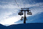 In the skiing area Zauchensee, Sportwelt Amadé, mountains, chairlift, clouds, sky, winter in Salzburg, Austria