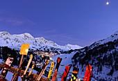 Evening view of Obertauern, ski resort, pass, mountains, snow, skis, lights, winter in Salzburg, Austria