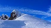 In the Obertauern ski area at Zehnerkar, snow, sky, ski lift, ski slope, clouds, Alps, winter in Salzburg, Austria