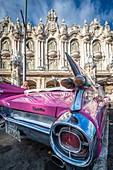 A vibrant classic pink Cadillac , Havana, Cuba