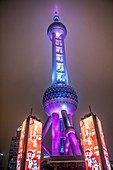 The colorfully lit Oriental Pearl TV Tower in Shanghai, China.