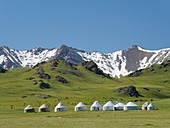 Yurts for tourists at lake Song Kol (Son Kul, Songkoel, Song-Koel).  Tien Shan mountains or heavenly mountains in Kirghizia. Asia, central Asia, Kyrgyzstan