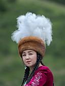 Musican in traditional garb. Folk Festival commemorating the origin myth the Tien Shan Maral (Tian Shan wapiti), an origin myth of the Kyrgyz tribes. Near Tasch Baschat, Naryn region. Asia, Central Aisa, Kyrgyzstan