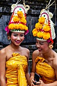 Happy Young Balinese Hindu Women At The Batara Turun Kabeh Ceremony, Besakih Temple, Bali, Indonesia.