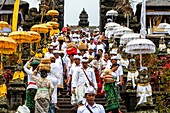 Balinese Hindu People At The Batara Turun Kabeh Ceremony, Besakih Temple, Bali, Indonesia.