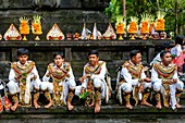 A Group Of Young Men In Costume Eating Lunch At A Hindu Festival, Tirta Empul Water Temple, Bali, Indonesia.