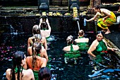 Foreign Visitors Bathing At The Tirta Empul Water Temple, Bali, Indonesia.