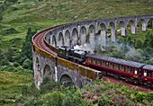 Jacobite express steam train crossing the Glenfinnan Viaduct on route from Mallaig to Fort William, Lochaber, West Highlands, Scotland