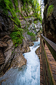 View of the steep walls and the wooden path in the Wimbachklamm, Berchtesgadener Land, Bavaria, Germany