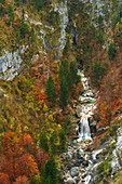 Top view of a large waterfall in the autumnal Garnitzenklamm, Carinthia, Austria.