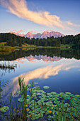 Sunset at Geroldsee with a view of the lake and the Karwendel massif, Bavaria, Germany.