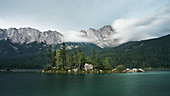 Shortly before a storm at Eibsee with a view of the Zugspitze massif (2962m), Bavaria, Germany.