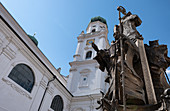 View of the church towers of St. Stephen's Cathedral, in the foreground St. Valentin at the Patronatsbrunnen, Passau, Lower Bavaria, Bavaria, Germany, Europe