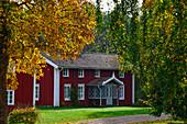 Old wooden villa surrounded by autumn leaves, near Vittaryd, Kronobergs Län, Sweden