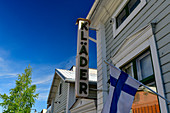 Old clothes shop with Finnish flag, Haparanda, Norrbottens Län, Sweden