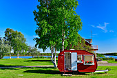Decorated red caravan in a front yard, Lovikka, Norrbottens Län, Sweden