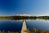 A long bathing jetty leads into a lake, Skaulo, Norrbottens Län, Sweden