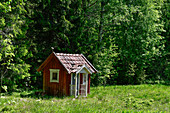 A very small hut stands in a clearing in the forest near Garphyttan, Örebro Province, Sweden
